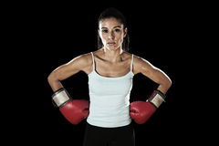 Latin fitness woman with girl red boxing gloves posing in defiant and competitive fight attitude Royalty Free Stock Photos