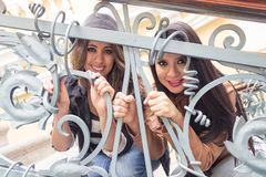 Latin friends behind staircase railings Royalty Free Stock Images