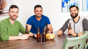 Latin friends hanging out at home Royalty Free Stock Images