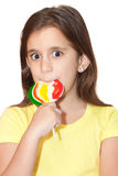 Latin girl with a colorful  lollipo Royalty Free Stock Image