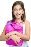 Latin girl with a colorful lunch bag Royalty Free Stock Photography