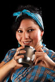 Latin girl with cup. In black background Stock Photography