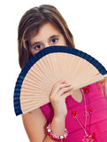 Latin girl hiding behind a fan isolated on white Stock Images