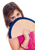Latin girl hiding behind a fan isolated on white Royalty Free Stock Photo