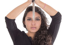 Latin girl holding knife with both hands Stock Photography