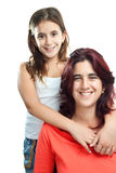 Latin girl hugging her mother Stock Images