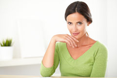 Latin girl looking smart in her green shirt Royalty Free Stock Photography