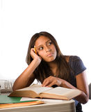 Latin girl with an open book. Daydreaming Royalty Free Stock Photography