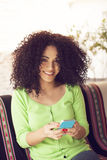 Latin girl with phone Stock Photography