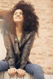 Latin girl smiling outdoors Royalty Free Stock Images