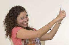 Beautiful latin girl takes selfie stock photo