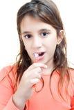 Latin girl washing her teeth Stock Images
