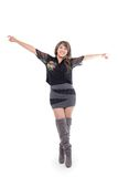 Latin girl wearing dress and boots posing with Royalty Free Stock Image