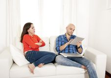 Latin girlfriend not happy with boyfriend playing on laptop Royalty Free Stock Image