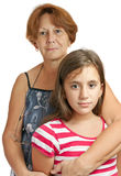 Latin grandmother hugging her granddaughter Royalty Free Stock Photos