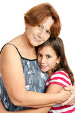 Latin grandmother hugging her granddaughter Stock Image