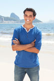 Latin guy with crossed arms at Copacabana beach at Rio de Janeiro Stock Photo
