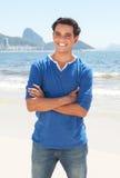 Latin guy with crossed arms at Copacabana beach at Rio de Janeiro Stock Photo