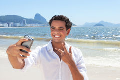 Latin guy making selfie at Copacabana beach Royalty Free Stock Photo