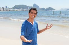 Latin guy presenting Copacabana beach at Rio de Janeiro Royalty Free Stock Photos