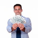 Latin guy smiling and holding cash Royalty Free Stock Photo