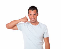 Latin guy standing with calling gesture Stock Photos