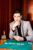 Latin handsome gambler man in table playing poker Stock Image