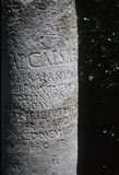 Latin inscription on old Roman column Royalty Free Stock Image