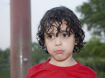 Latin Kid's Sad Face. Hispanic Boy's face after the playing with water was over. Natural expression Royalty Free Stock Photo