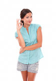 Latin lady in blue blouse gesturing a great job Stock Photo