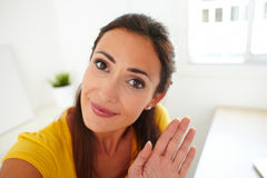 Latin lady greeting a person on webcam Royalty Free Stock Images