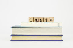 Latin language word on wood stamps and books Stock Photos
