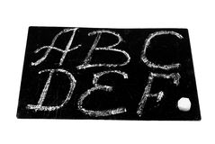 Latin letters. Written by a chalk on a black board Royalty Free Stock Photography