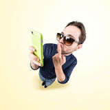 Latin lover make a funny face, and take a self portrait with his Royalty Free Stock Photography