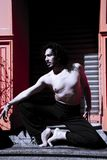Latin male dancer posing with dancing figures. Urban background royalty free stock photos