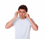 Latin male having a headache with hands on head Stock Photos