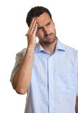 Latin man in a blue shirt feels sad Royalty Free Stock Image