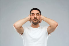Latin man covering his ears with hand palms Royalty Free Stock Photo