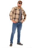 Latin man in flannel shirt cap and sunglasses Royalty Free Stock Photo
