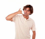 Latin man gesturing call me sign Royalty Free Stock Images