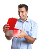 Latin man gets a nice surprise as christmas gift Royalty Free Stock Photos