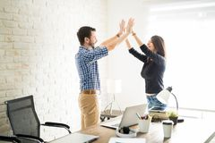 Latin man giving high five to his partner royalty free stock image