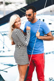 latin man hugging sexy blonde woman on yacht Royalty Free Stock Photos