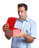 Latin man with present Royalty Free Stock Image