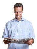 Latin man reading newspaper Royalty Free Stock Photo