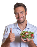 Latin man recommending fresh salad Stock Photography