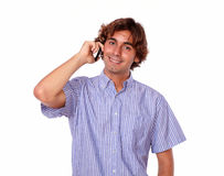 Latin man smiling while talking on his cellphone Royalty Free Stock Photos