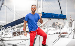 Latin man standing on yacht and looking at stormy sky Stock Photography