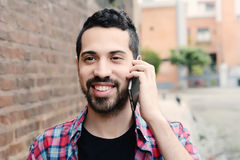 Latin man talking on the phone Stock Images