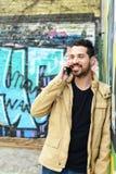 Latin man talking on the phone. Stock Photo